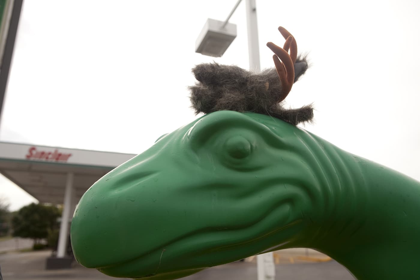 Flopsy the Jackalope with a Sinclair Station Dinosaur in Missouri